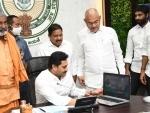 Andhra Pradesh Chief Minister Y S Jagan Monhan Reddy releasing Cheque