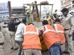 Police taking away illegall stalls during anti-encroachment drive in Ranchi