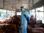 Buses to carry migrant workers get disinfected