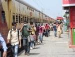 Migrants from Tamil Nadu boarding buses amid lockdown