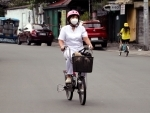 Worker rides bicycle in Phiippines