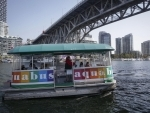 Aquabus ferry carries a few tourists on board in Vancouver