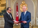 Tunisian Prime Minister-designate Hichem Mechichi presents his proposed composition for new government to Tunisian President Kais Saied