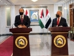 Iraqi Foreign Minister Fuad Hussein (R) and Jordanian Foreign Minister Ayman Safadi attend press conference in Baghdad