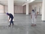 J&K: Men cleaning board at Yatri Niwas base