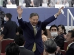 Japans Chief Cabinet Secretary Yoshihide Suga acknowledges his election as new President
