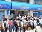 Depositors gathered outside Yes Bank branch in Ahmedabad for money withdrawal