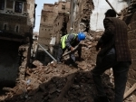 Sanaa:Workers remove rubbles from the ruins of a historic building