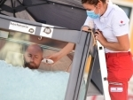 A medical worker checks Josef Koeberl's temperature as he stayed under ice for over 2.5 hrs in Melk, Austria