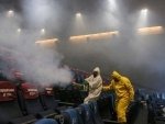 Workers sanitize movie hall in Mexico City