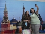 Passengers taking selfie at Sheremetyevo International Airport after Russia resumed air service partially