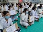 Karnataka health workers stage dharna