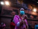 Woman offers prayer on Janmasthami festival at a temple in Nepal