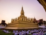 People praying at Luang Stupa in Vientiane, Laos after Covid-19 situation eased