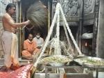 Uttar Pradesh Chief Minister Yogi Aditiyanath offering prayers to Lord Shiva at Kanshi-Vishwanath temple