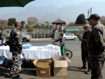 CRPF jawans provides face masks and sanitizer to the local tourists in Srinagar