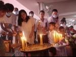 People light incense sticks at a pagoda in Phnom Penh