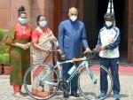 President Ram Nath Kovind gifts racing bike to an aspiring cyclist at Rashtrapati Bhawan