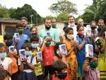 Mumbai: BJP leader Sanjay Pandey distributes smart phones to support tribal students