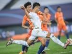 Beijing: Lin Liangming of Dalian FC shoots and scores