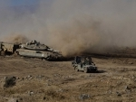 Israeli soldiers drive military vehicles during an exercise in the Israel-occupied Golan Heights