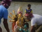Glimpses of immersion of Goddess Durga's idols at Kolkata's Babughat