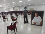 Nitish Kumars virtual rally: Worker carries Gandhi's portrait