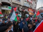 Palestinians take part in a protest against the Arab-Israeli normalization agreements