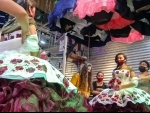 People with masks shop in a store in Mexico City