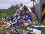 Broken Air India Express Boeing 737 repatriation flight lies amid debris in Kozhikode, Kerala