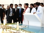 Sri Lankan Prime Minister Mahinda Rajapaksa listening to the latest report on the construction of Port City project in Colombo