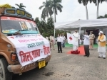 Bihar governor Fagu Chauhan flags off the trucks loaded with relief materials