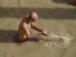 Varanasi: A devotee offering prayer in holy river Ganga