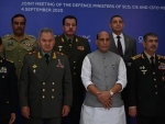 Rajnath Singh poses for photograph with heads of Defence Ministers of SCO, CIS and CSTO members in Moscow