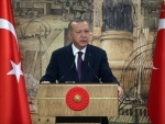 Turkish President Recep Tayyip Erdogan delivers a televised speech in Istanbul