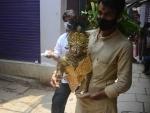 People in Varanasi taking home Laddoo Gopal idols on Janmashtami