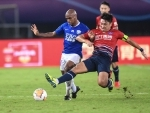 Luiz Muriqui of Shijiazhuang Ever Bright vies for the ball