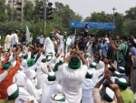 Farmers under the banner of Bhartiya Kisan Union staging a Chakka Jam in Noida