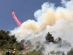 Firefighters battle against a wildfire in Riverside County of Southern California