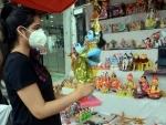 Janmasthami: A girl purchasing earthen idol of Lord Krishna