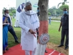 Nitish Kumar ties Rakhi to a tree