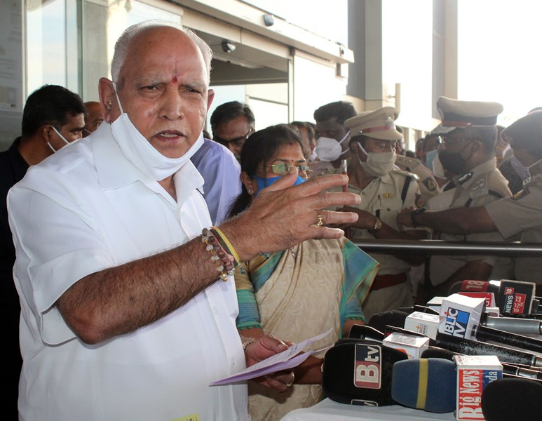 Karnataka CM B S Yeddyurappa speaks to media persons at Sambra Airport in Belagavi