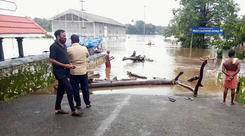 A view of roads in Aluva town submerged under water