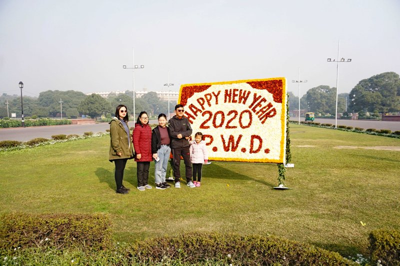 Tourists pose for photograph in New Delhi