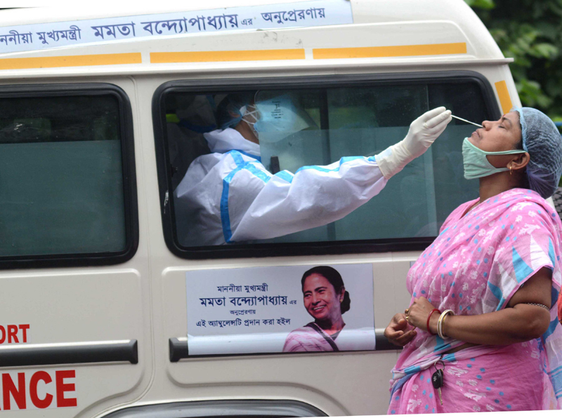Health workers in Kolkata collect samples for Covid testing