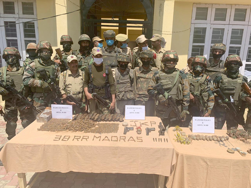 Joint teams of police and army recover cache of arms