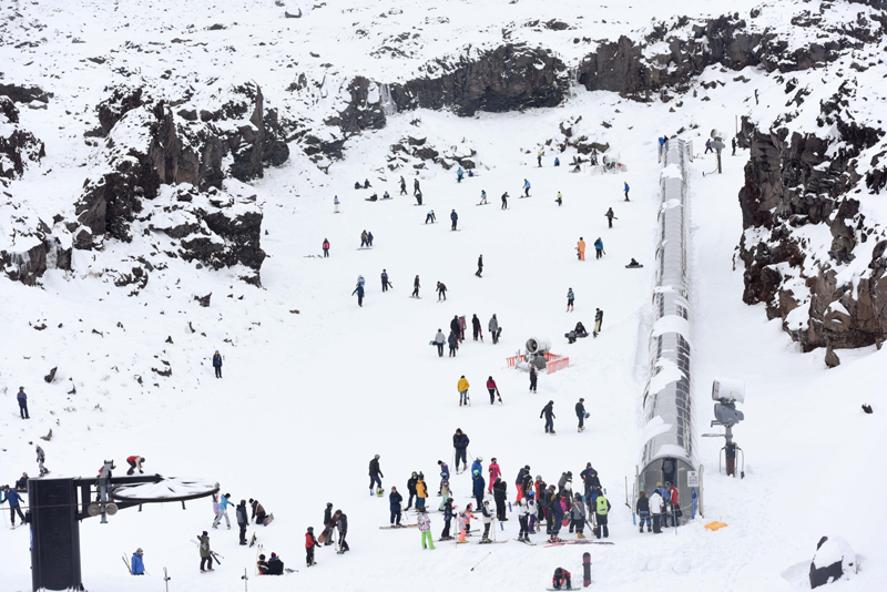 People ski at Whakapapa ski field in New Zealand