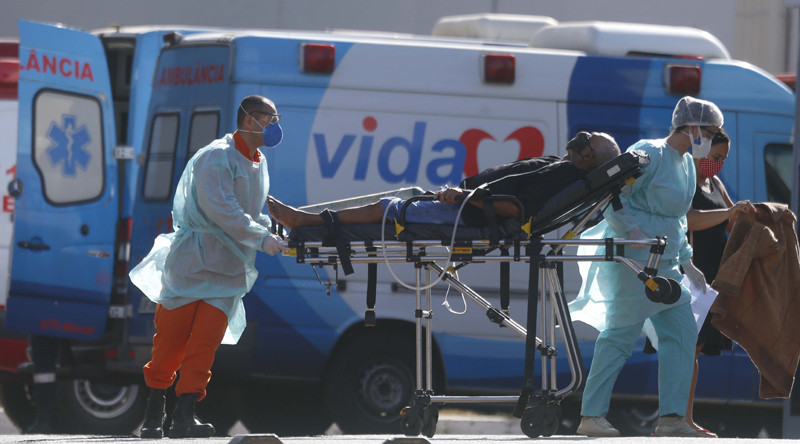 A COVID-19 patient is brought to a hospital by health workers in Brasilia