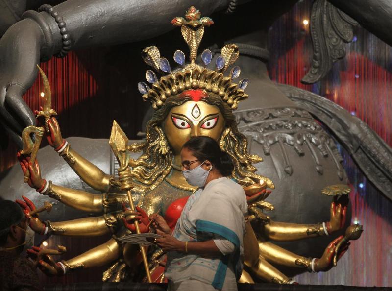 Mamata Banerjee performs Goddess Durga's 'Chokkhudaan' at Kolkata's Chetla Agrani Club