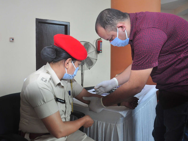 A women Assam Police personnel donating plasma